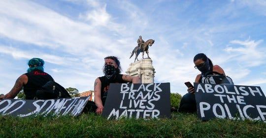 This Tuesday, June 2, 2020 file photo shows a part of a large group of protesters gather around the statue of Confederate General Robert E. Lee on Monument Avenue near downtown in Richmond, Va.