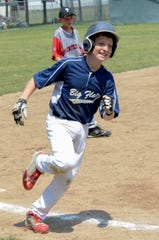 This photo of Henry Juan rounding third while playing for the Big Flats Little League all-stars was one of thousands taken by his mom, Mary Juan.