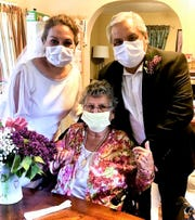 The couple receives a blessing from maternal Grandma Maria Riojas at her home after the ceremony.