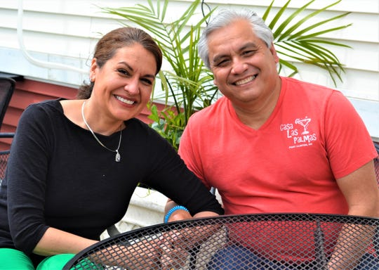 Kelley Kurtz and Camilo Rayo were married in a window wedding on the porch at Ottawa Riverview Health Care Campus so that Kelley's grandmother, Dorothy Kurtz, could attend the ceremony. The wedding was planned and held just three days after Kurtz was placed in hospice care. She died five days later. Here, Kelley and Camilo sit on the patio of Camilo's Port Clinton restaurant, Casa Las Palmas.