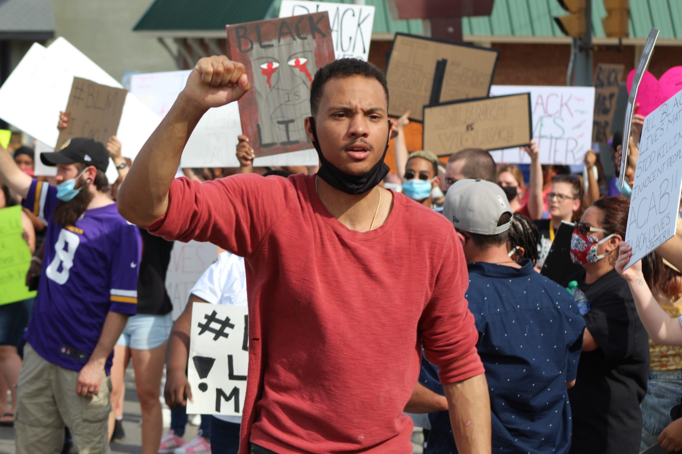 Hundreds of Fremont residents march in an anti-racism vigil in Fremont on Wednesday.