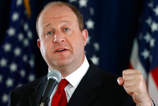 In this Thursday, May 28, 2020, file photograph, Colorado Governor Jared Polis makes a point during a news conference about the state's efforts against the new coronavirus in Denver.