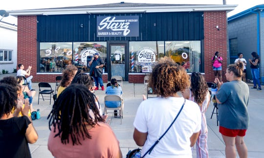 Starz Barber and Beauty of Green Bay Owner Chris Kimbrough asks the crowd if anyone wants to come up and speak about their experiences as well as solutions to the problem of racial injustices and police brutality on Wednesday, June 3, 2020, at Starz Barber and Beauty of Green Bay in Ashwaubenon, Wis. Ebony Cox/USA TODAY NETWORK-Wisconsin