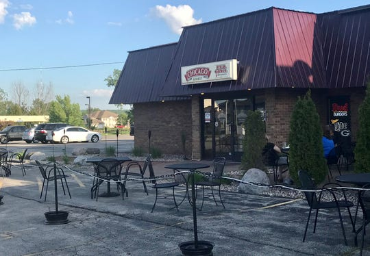 Chicago Street Pub, Grill & Banquets in De Pere has expanded its patio seating into the parking lot this summer.