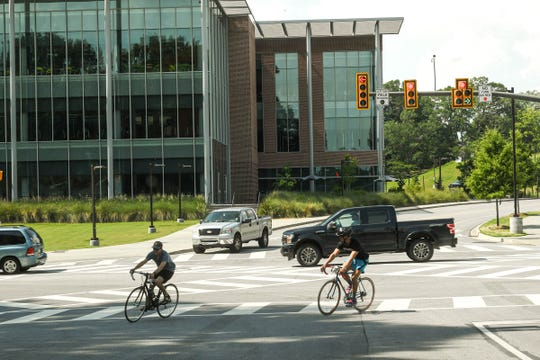 Bicycle riders turn off of State Highway 93 at Clemson University, in the fourth month of a Coronavirus-19 forced shutdown before the campus reopens soon.