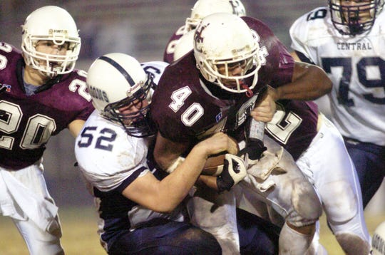 Warren Central's Wes Jeffries tries to haul down Cedric Rainey during the 2004 regional championship game.