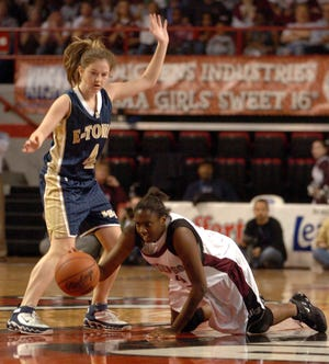 Henderson County's Alyse Poindexter (54) tries to keep the ball in play from her knees as Elizabethtown's Jenna Goblirsch (4) defends during the 2006 girls state tournament game in Bowling Green.