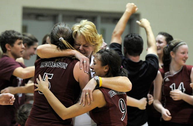 Henderson County head coach Anita Watkins embraces Jenna Hess (5) and Chelsey Shelton (9) after the Lady Colonels won the 2008 regional championship against Caldwell County in Princeton.