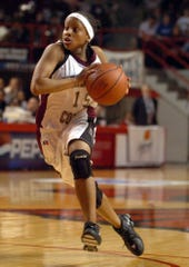 Henderson County's Sierra Gilbert (15) drives the lane during the 2006 state tournament game against Elizabethtown in Bowling Green.