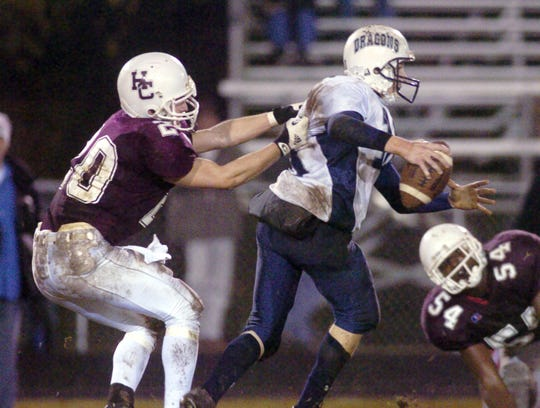 Henderson County's Andrew May sacks Warren Central's quarterback Blake Ayers during the 2004 regional  championship game at Colonel Field.