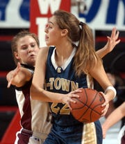 Henderson County's Tara McConnell (24) puts heavy pressure on Elizabethtown's Angela Lucas (22) during the 2006 girls state tournament game in Bowling Green.