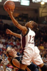 Henderson County's Rinesha Soaper (12) drives to the basket over Elizabethtown's Alisa Dickerson (44) during the 2006 girls state tournament game in Bowling Green.