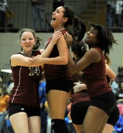 Henderson County's Ashley Crooke, center, rejoices with teammates after the Lady Colonels won the 2008 regional championship against Caldwell County in Princeton.