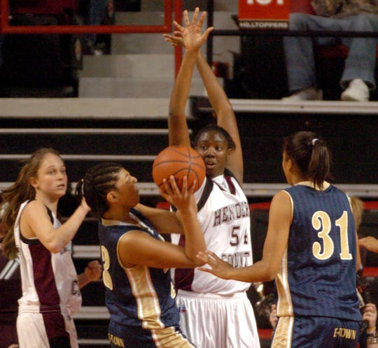 Henderson County's Alyse Poindexter (54) tries to block Elizabethtown's Alex Jones (43) during the 2006 girls state tournament game in Bowling Green.