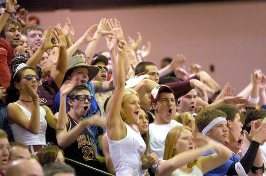 The Henderson County student section cheers during the 2006 Second Region Tournament championship at Madisonville-North Hopkins High School.