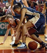 Henderson County's Sara Scales tangles with Elizabethtown's Kabrenda Warfield (31) for the loose ball during the 2006 state tournament game in Bowling Green.