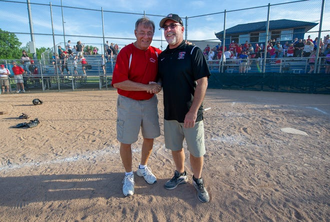 Martinsville softball coach Ken Rhoden, left, and Center Grove coach Russ Milligan share a moment after the championship game of an IHSAA sectional at Franklin Central, May 23, 2018.