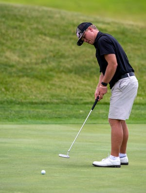 Harrison's Nic Hofman watches his ball roll toward the cup on hole 17 at the Legends Golf Course in Franklin on Thursday during the 2020 Indiana Senior Open.