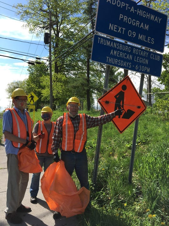 From left: Rotarians Joseph Barrett, Mary Bouchard, and Durand Van Doren braved the hot, humid weather to clean up their Adopt-A-Highway section of Route 96 in Trumansburg Village and beyond.