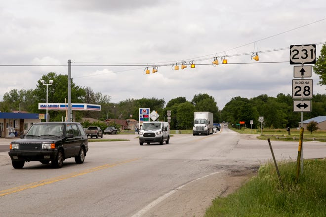 Cars travel along U.S. 231 at the Indiana 28 intersection, Thursday, June 4, 2020 in Romney.