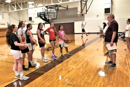 Berne Union girls basketball coach Matt Little gives his players instructions during their workout Wednesday morning. The players are, from left to right, Mina Gronbach, Sophia Kline, Emily Blevins, Baylee Mirgon, Bella Kline and Abbi Evans.