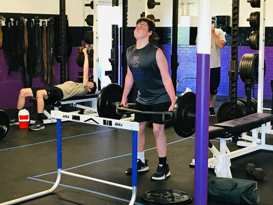 Bloom-Carroll freshman Tristan Britch works in the weight room Tuesday as the members of the Bulldogs' football were allowed to begin taking part in training.