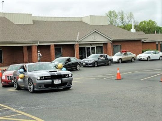 """Members of the Fairfield Christian Academy class of 2020 line up in their cars during the """"Senior Clap Out"""" on Friday, May 26, as teachers and faculty celebrated what would have been seniors' last day of school, if schools hadn't been closed due to the coronavirus pandemic."""