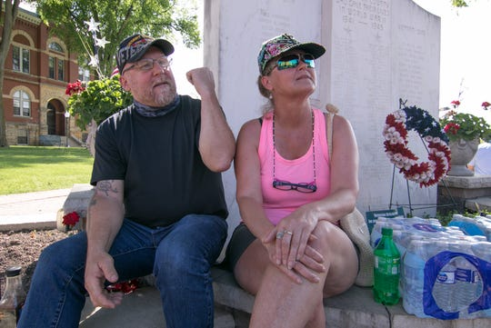 "Operation Desert Storm veteran and Howell resident Thomas LaMay, sitting with his girlfriend, Rachel Schloss, says at a support rally Thursday, June 4, 2020 ""I'm trying to protect [the Livingston County Veterans Memorial] to make sure nothing happens."""