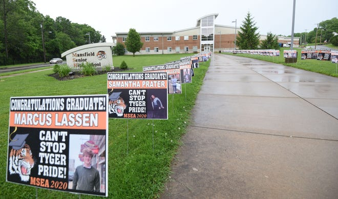 Signs honoring each member of the Class of 2020 line the sidewalk leading to Mansfield Senior High School. Richland County educators are looking to Gov. Mike DeWine and the Ohio Department of Education for guidance on reopening in Ohio.