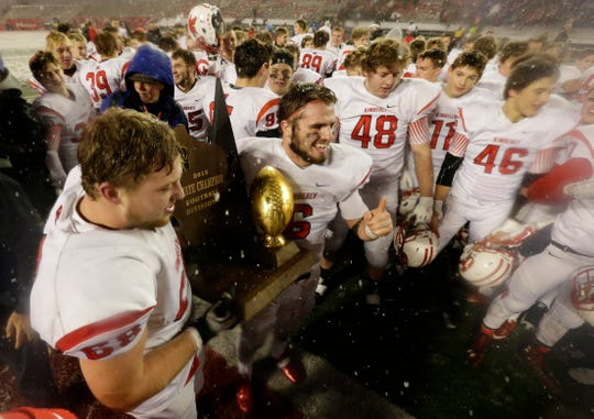 Kimberly players celebrate as snow falls on Camp Randall Stadium after their comeback victory over Arrowhead in the 2015 WIAA Division 1 title game.
