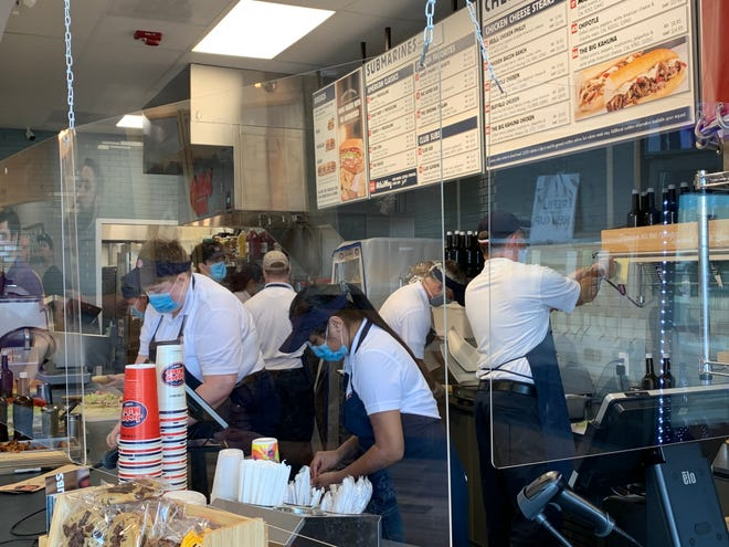 Workers fill takeout orders on the second day of business inside the new Jersey Mike's restaurant in Waukesha. The store opened June 3, but without the usual pre-opening promotions, and with no indoor seating for now, due to concerns over the coronavirus pandemic.