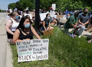 Brookfield residents and students kneel for 9 minutes. Protesters gathered outside the Brookfield Public Library to peacefully support the Black Lives Matter movement and draw attention to racial injustice. Their rally is in response to the death of George Floyd, who died  at the hands of a Minneapolis police officer.