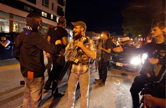 Some men toting guns joined a march protesting the death of George Floyd at the hands of a Minneapolis police officer Wednesday evening in Milwaukee. (Photo: Rick Wood/Journal Sentinel)