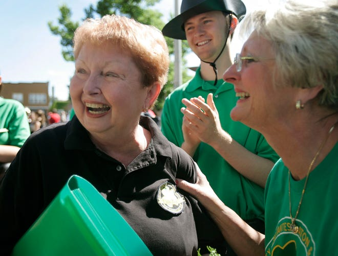 Daley Debutantes Baton and Drum Corps founder Sherry Jung receives accolades from her sister Patti Wertschnig and team members before they perform at the West Allis Fourth of July Parade in 2005. Jung, who founded the group in 1955, died May 27 at the age of 80.