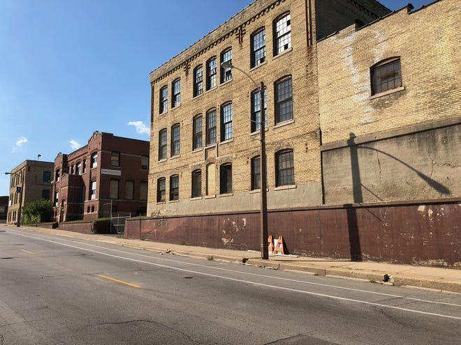 The Community Within The Corridor will redevelop a group of historic former industrial buildings into apartments and commercial space.