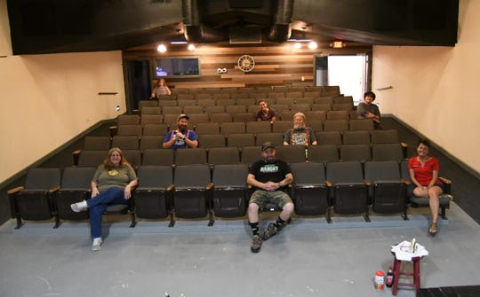 """The cast and crew of the Twin Lakes Playhouse's production of """"Catfish Moon"""" demonstrate the social distancing seating requirements that will be in place when the playhouse re-opens on Friday, June 12. Every other row of seats in the audience will be roped off, and audience members should sit with three seats in between them and others. Family groups will still be allowed to sit next to one another."""