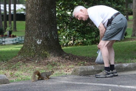 Bob Draper puts down sunflower seeds and talks to one of the squirrels at Kiroli Park in West Monroe on Thursday, June 4, 2020.