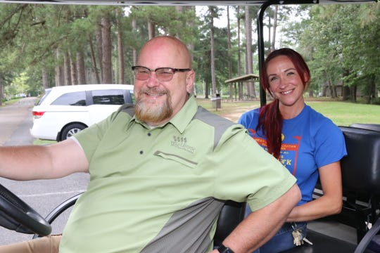 Doug Seegers, director of West Monroe's Parks and Recreation Department, rides in a cart with park manager Haley Martin She also acts at the head of horticulture for the city.