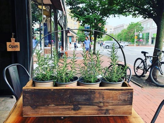 The chef of Samba in Montclair tends to his herb garden that surrounds its alfresco dining space