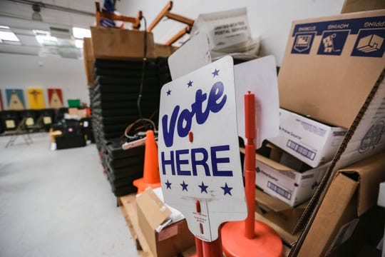 A vote here sign sits in the Doña Ana County Clerk's Bureau of Elections Warehouse in Las Cruces on Thursday, June 4, 2020.