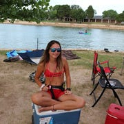 Kendal Parham, City of Carlsbad lifeguard, takes a break on July 4, 2019. The City of Carlsbad postponed this year's fireworks show. All beach and park areas will remain open on Independence Day.