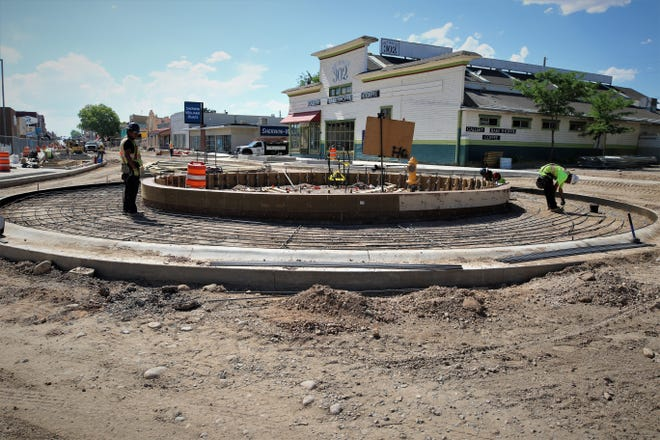 Workers from general contractor AUI Inc. in Albuquerque put a support structure in place for a 24.5-foot roundabout at the corner of East Main Street and Miller Avenue in downtown Farmington on June 4, 2020. The inner ring of the roundabout will be filled with dark-shaded concrete in the next few days.