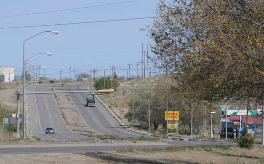 Vehicles move on U.S. Highway 491 in the north side of Shiprock during the weekend lockdown on April 25. Navajo Nation President Jonathan Nez signed an executive order to end the restriction for residents on the reservation.