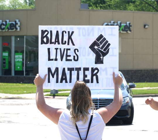 A protester holds a Black Lives Matter sign during the June 4, 2020 demonstration at Seven and Middlebelt.