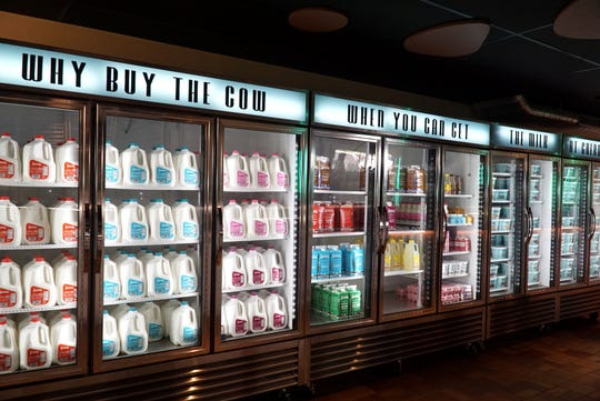 Guernsey Farms Dairy's interior is completely redesigned and features brand new equipment like this bank of coolers for their dairy products.