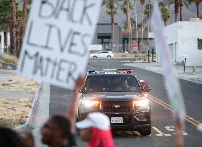Protesters march to protest police violence and to remember George Floyd in Rancho MIrage, June 3, 2020.