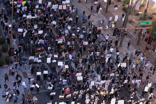 Protesters march through downtown Phoenix on June 3, 2020.