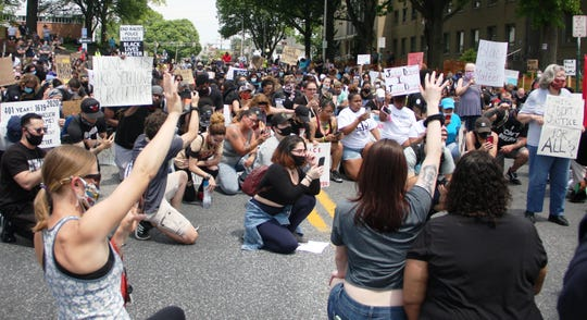 Protesters at Thursday's rally take a knee as a show of solidarity during a police brutality protest held in Lebanon on Thursday, June 4, 2020.