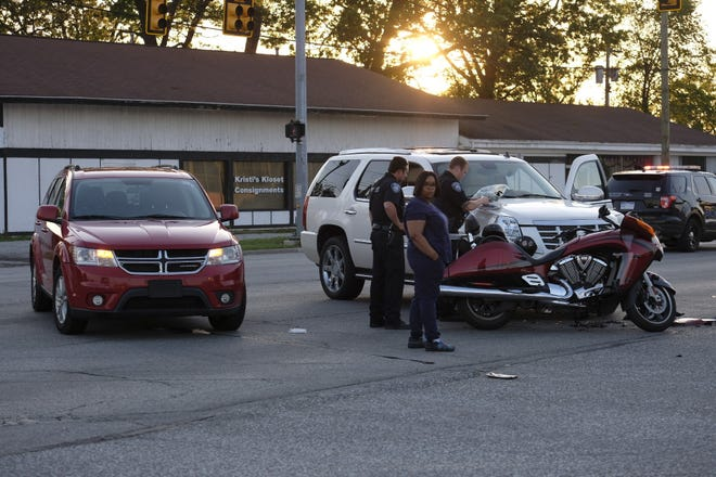 Rescue crews respond to a crash on Pine Grove Avenue Wednesday evening, June 3, 2020, in Port Huron. Port Huron Police Officer Andrew Robertson said a motorcycle northbound on Pine Grove Avenue was hit by a southbound SUV attempting to turn east onto Holland Avenue.