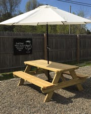 Outdoor seating at Grand Cru Beer & Cheese Market in Rhinebeck.